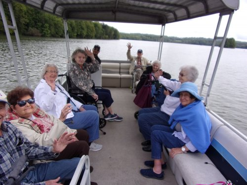 Residents riding on the pontoon at clear fork lake and having a picnic.