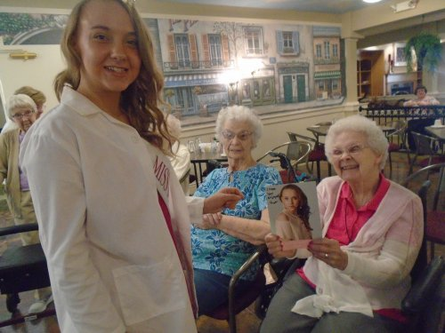 Miss Outstanding teen Mohican Valley, Paige Robertson, visits with residents