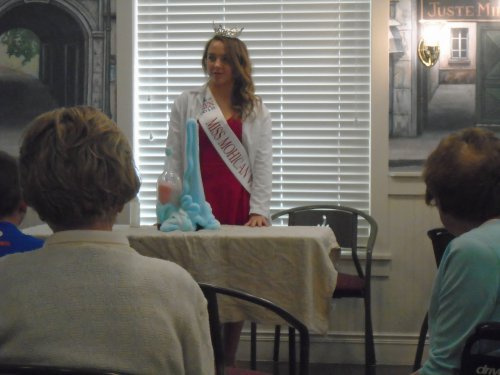 Miss Outstanding teen Mohican Valley, Paige Robertson, demonstrates her talent portion of her competition and talks with resident's.