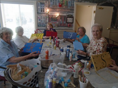 Primrose residents participating in painting door decorating project