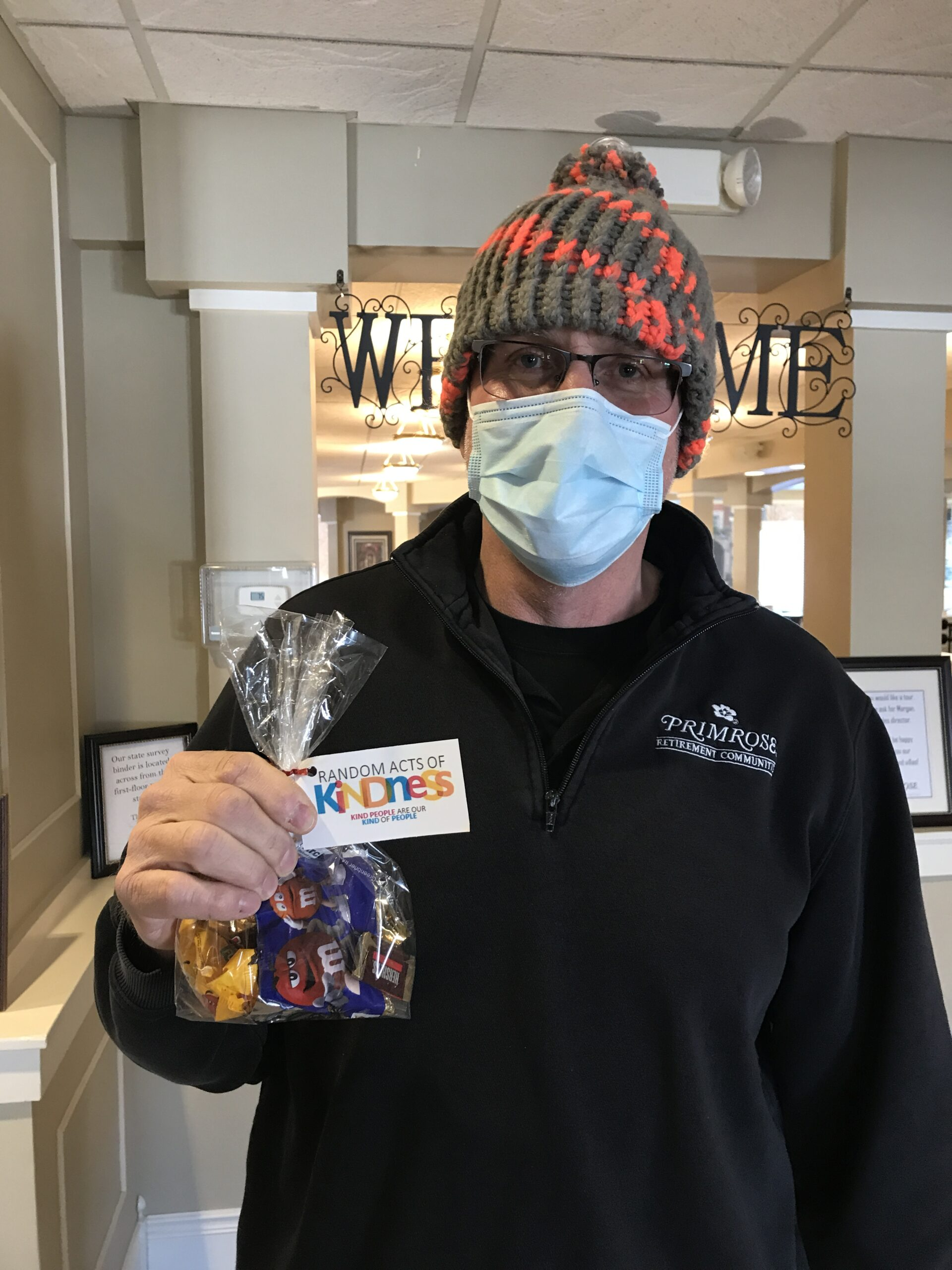 David posing with his handmade hat made by the busy bees and with his goody bag full of candy and gift card for Random Act of Kindness Day
