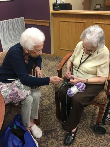 Mary Ellen was teaching Chloe how to knit today.