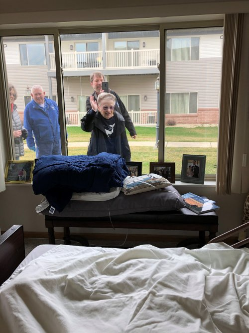 Cindy M. stops by for a window visit with her husband, Karl. Cindy brought a birdhouse over so that Karl can enjoy bird watching from his window!