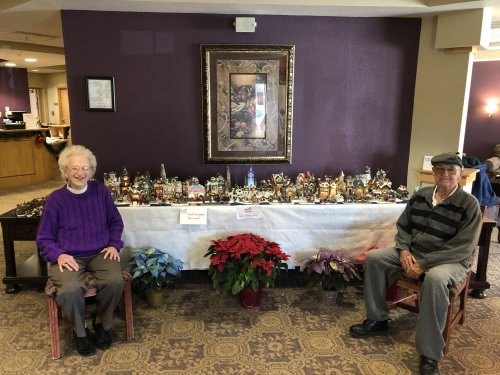 Randy and Betty in front of their Christmas Village they set up each year.