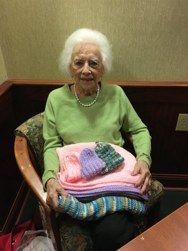 Mary Ellen made baby blankets and hats to give to new born babies in the hospital.