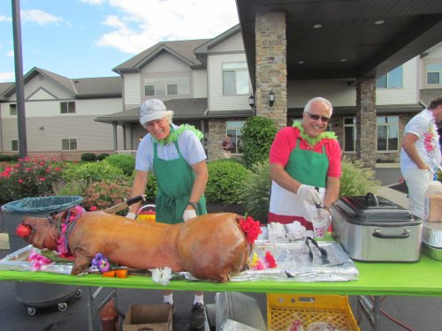Mike Nicolosi and crew put the final touches on the Luau hog.