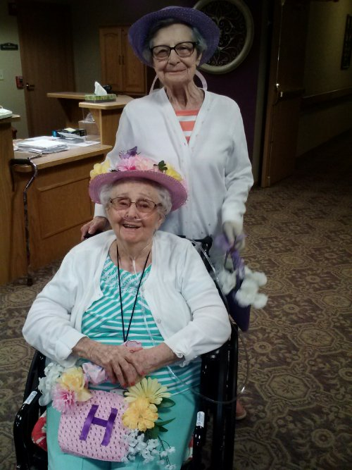 Phyllis and Faye showing off their handiwork during craft time. Homemade hats and purses to match.