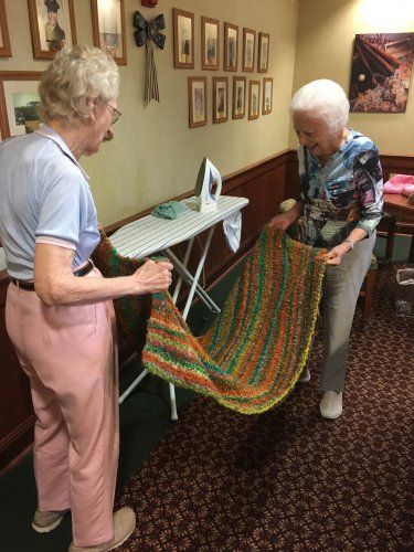 Betty and Mary Ellen ironed this blanket that will be donated to the hospital.