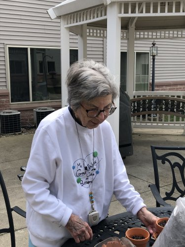 Delores took some time to step outside and enjoy the weather as well as plant some flower seeds!