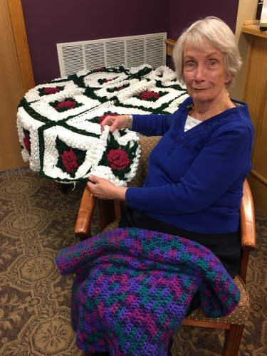 Dee showing us her beautiful knit bed spread she made.