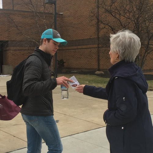 Resident Dee Basinger hands out gift cards to students at The Ohio State University, Marion on Make a Difference Day, February 15, 2017.