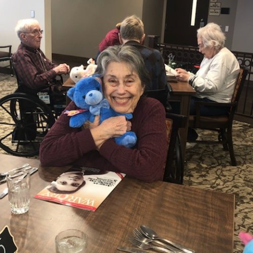 Barb loves the Valentines card and bear she received from the kids from the Salvation Army after school program.