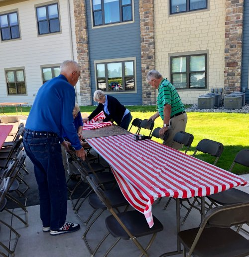 Our Residents are busy helping set up for our Family Picnic