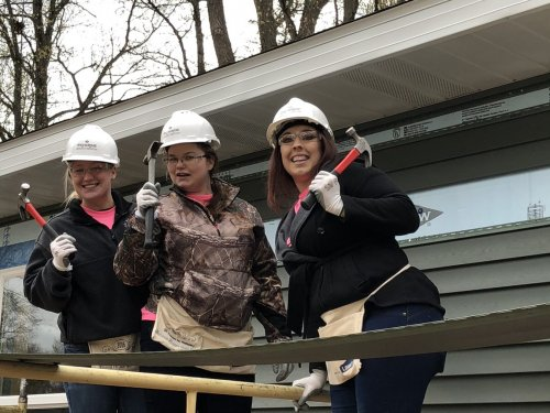 Linde, Courtney and Katlynn worked together to side one whole side of the house.