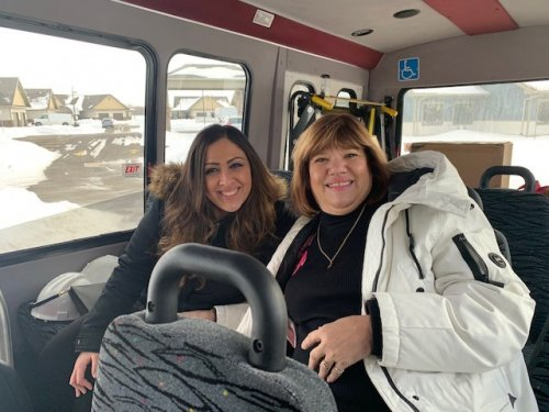 Nurse Kaitlyn and Jane going for a ride on our bus.