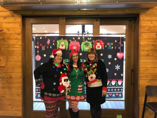 Executive Director Crystalee, Director of Nursing Kaitlyn, and Sales Director Jane Johnson at the ugly sweater event hosted for referral sources.