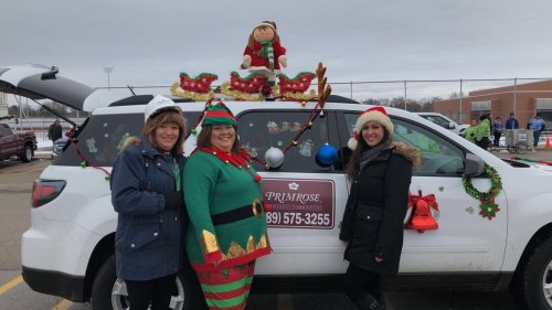 Sales Director Jane Johnson, Executive Director Crystalee Cook, and Director of Nursing Kaitlyn Driver representing Primrose in Midland's annual Santa parade