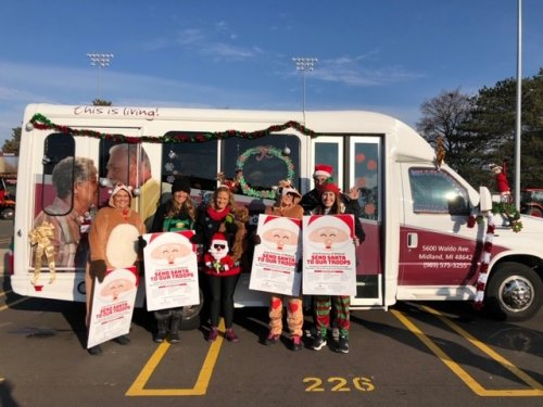 Our team all ready for the Santa Parade to start with a bus full of residents enjoying hot chocolate and Christmas Carols.