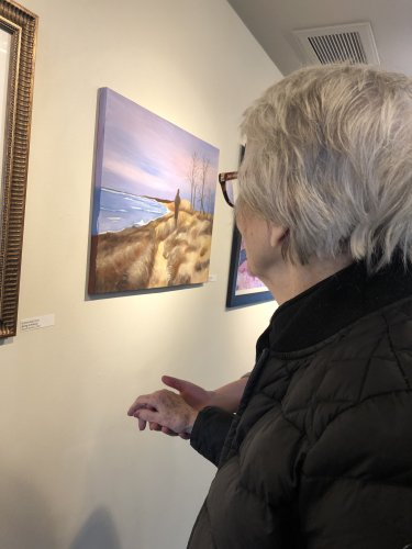 resident Shirley with her artwork displayed at the creative 360