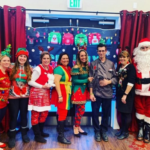 Leadership team ready for our Ugly Sweater Party for our referral sources.