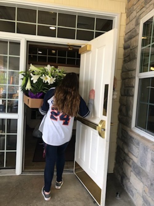 Jenni delivering some of our donated flowers to Bickford to help brighten up their day.