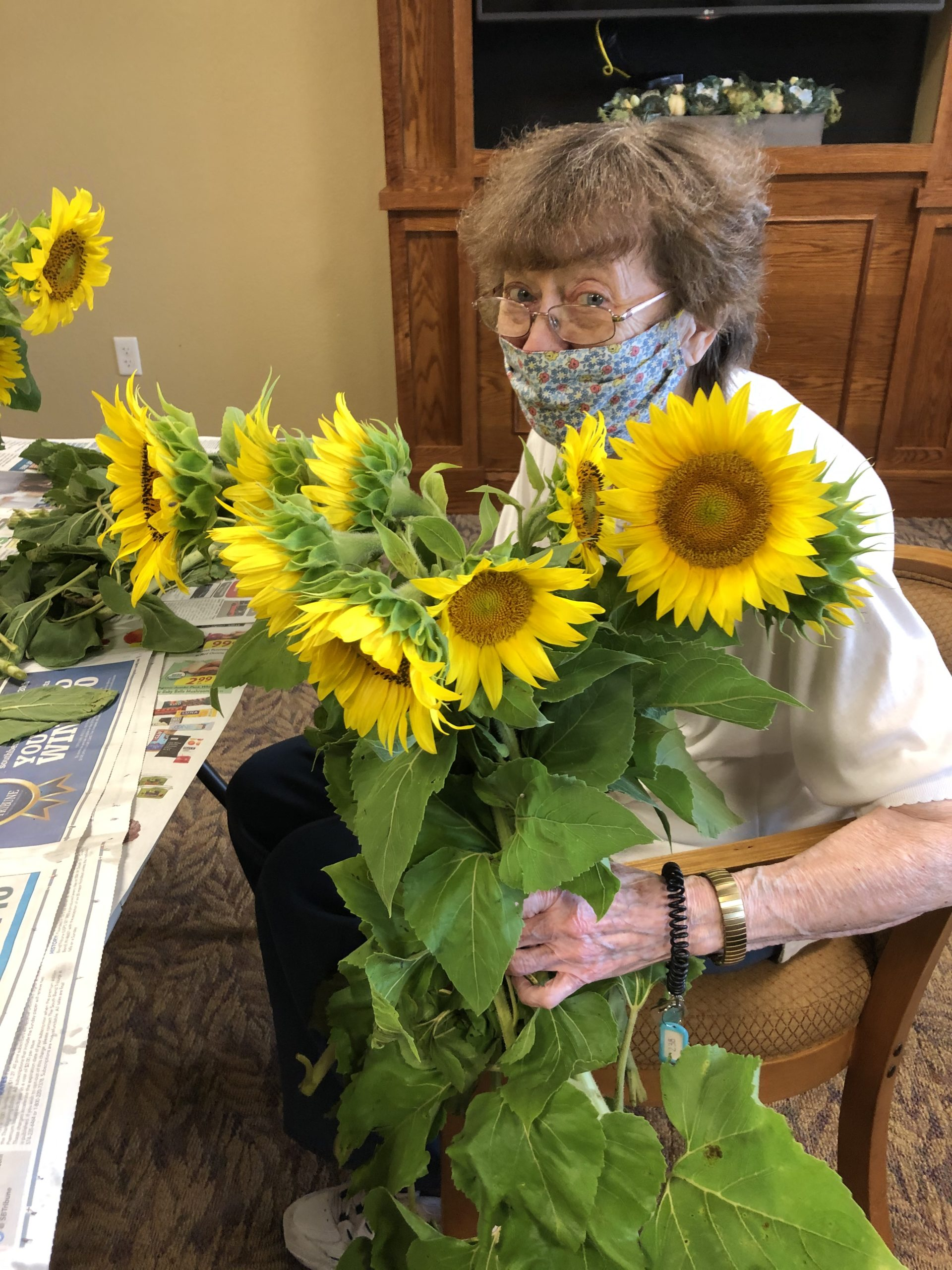 Helen with a happy bunch of sunflowers.