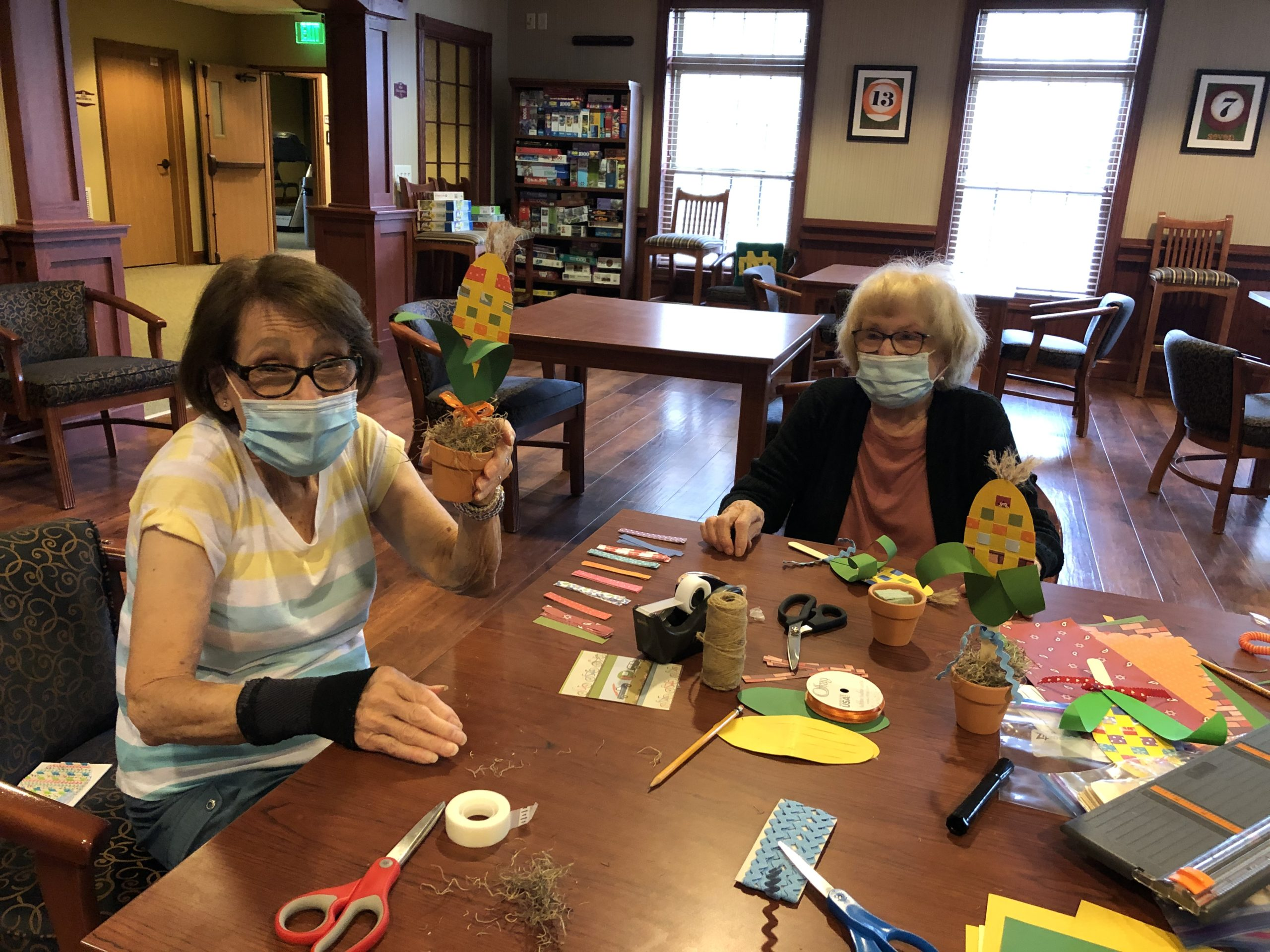 Edie and Gloria were busy making cheerful corn decorations.