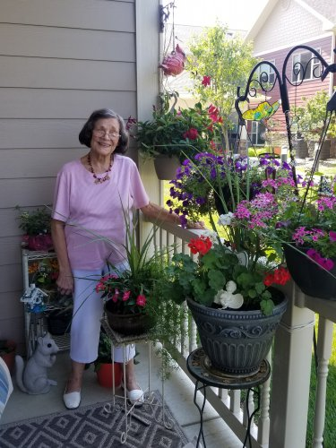 One of our residents showing her beautiful flowers she has planted on her balcony!