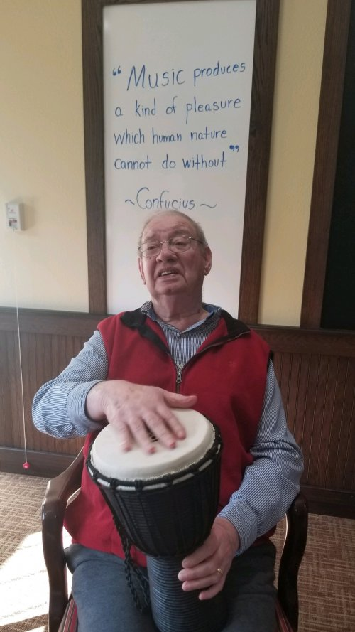 At Primrose Memory Care, Bob plays the drums to his favorite tune!