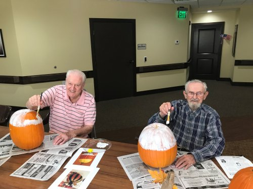 LeRoy and Albert paint pumpkins to celebrate October.