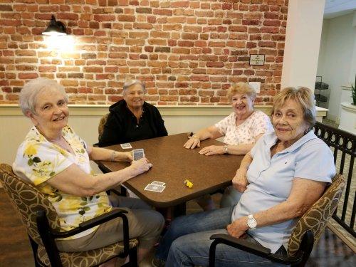 Anna, Rose, Marlene and Joan enjoys a game of Euchre at Primrose Newburgh!