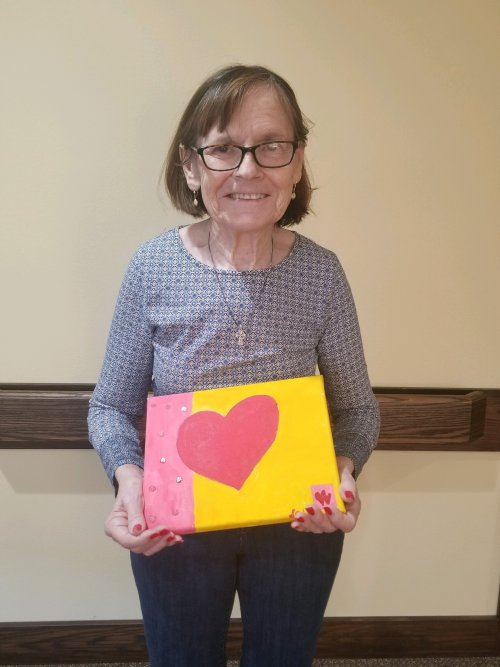 Suzi gets ready for Valentine's Day by painting this for the community!