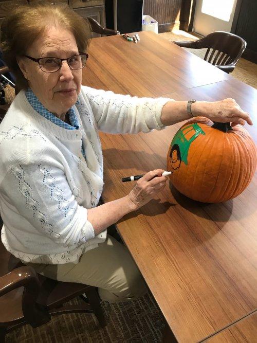 June paints a John Deere pumpkin for our Primrose farmer!