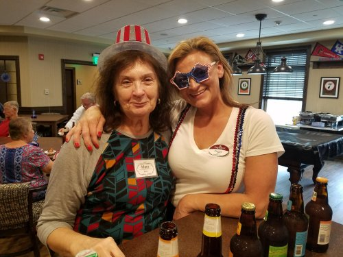 Taking a photo break from the American Craft Beer Event! Residents enjoyed dressing in red, white and blue!