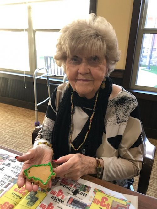 Carol makes Christmas cookie ornaments for our community Christmas tree.