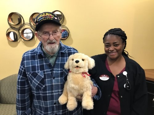 Albert enjoys his new dog from Pets For Vets