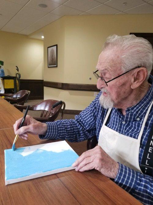 Albert is preparing his painting.