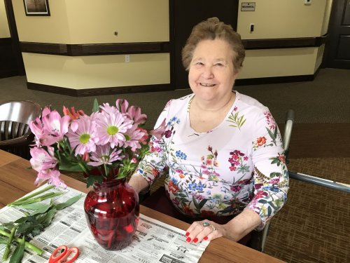Colleen made a beautiful arrangement and a smile to match!