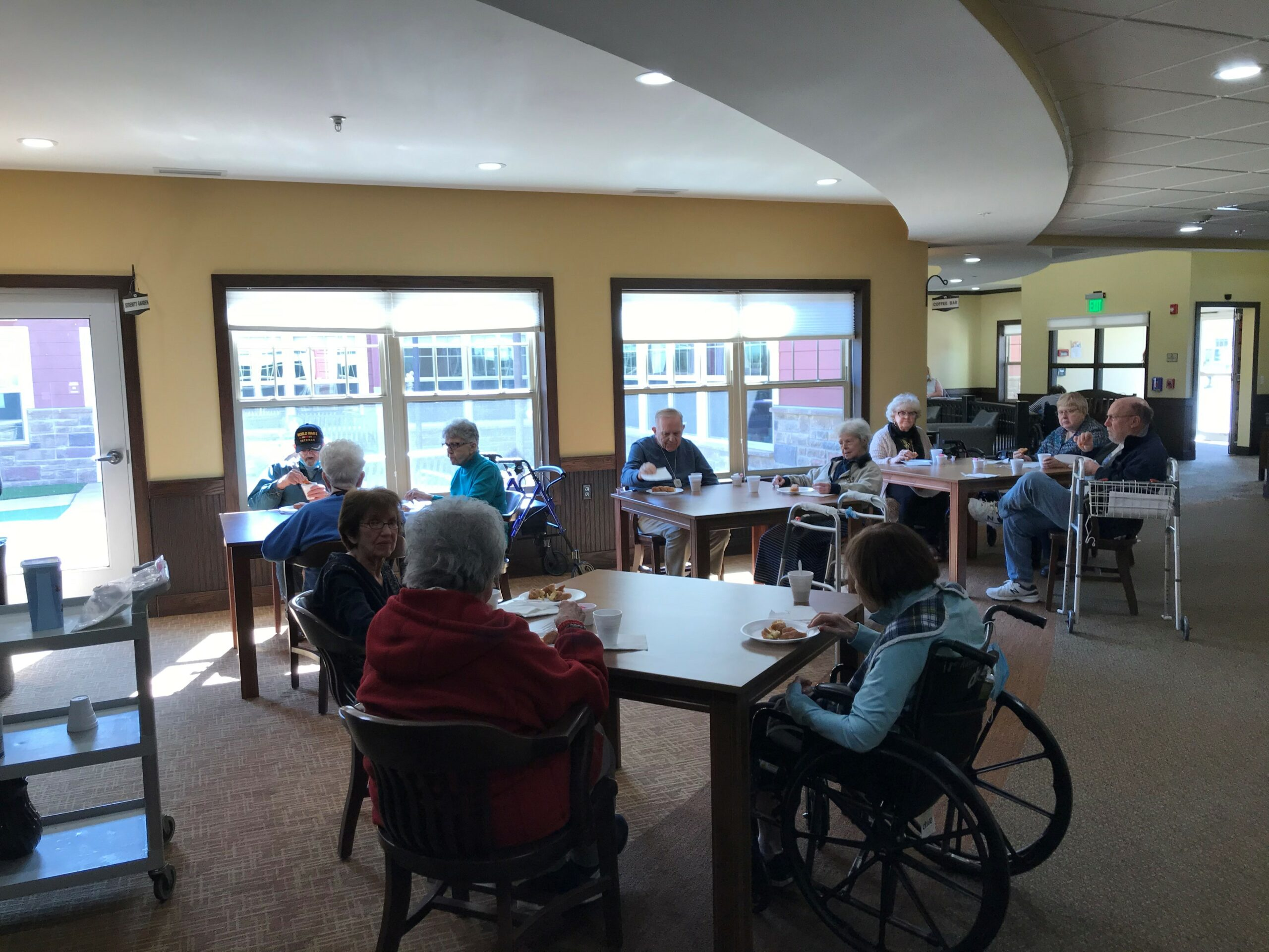 Memory Care residents enjoying tasty pastries, coffee and conversation