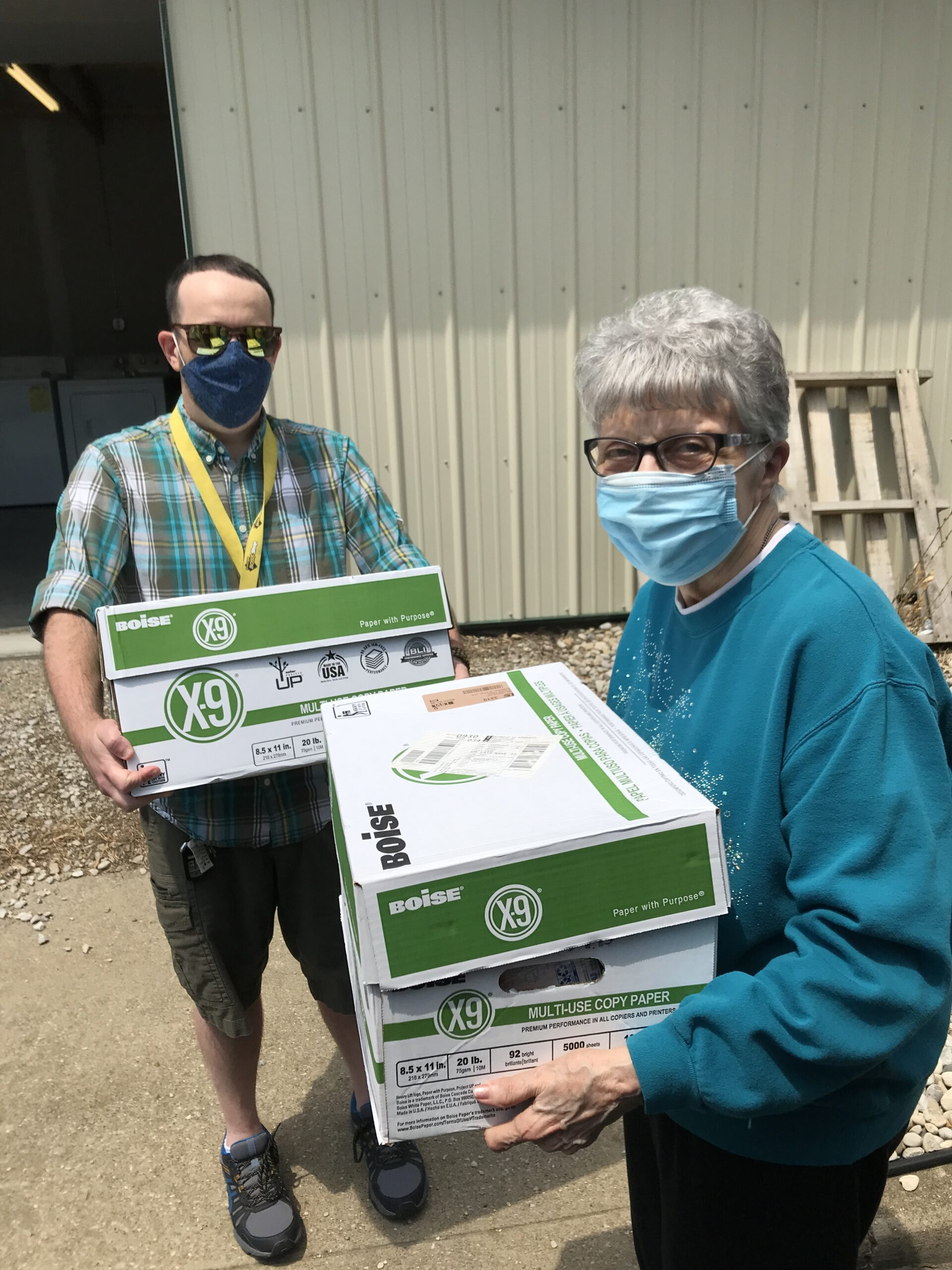 Mary Nell assisting Aurora's Nathan Jochum with donations