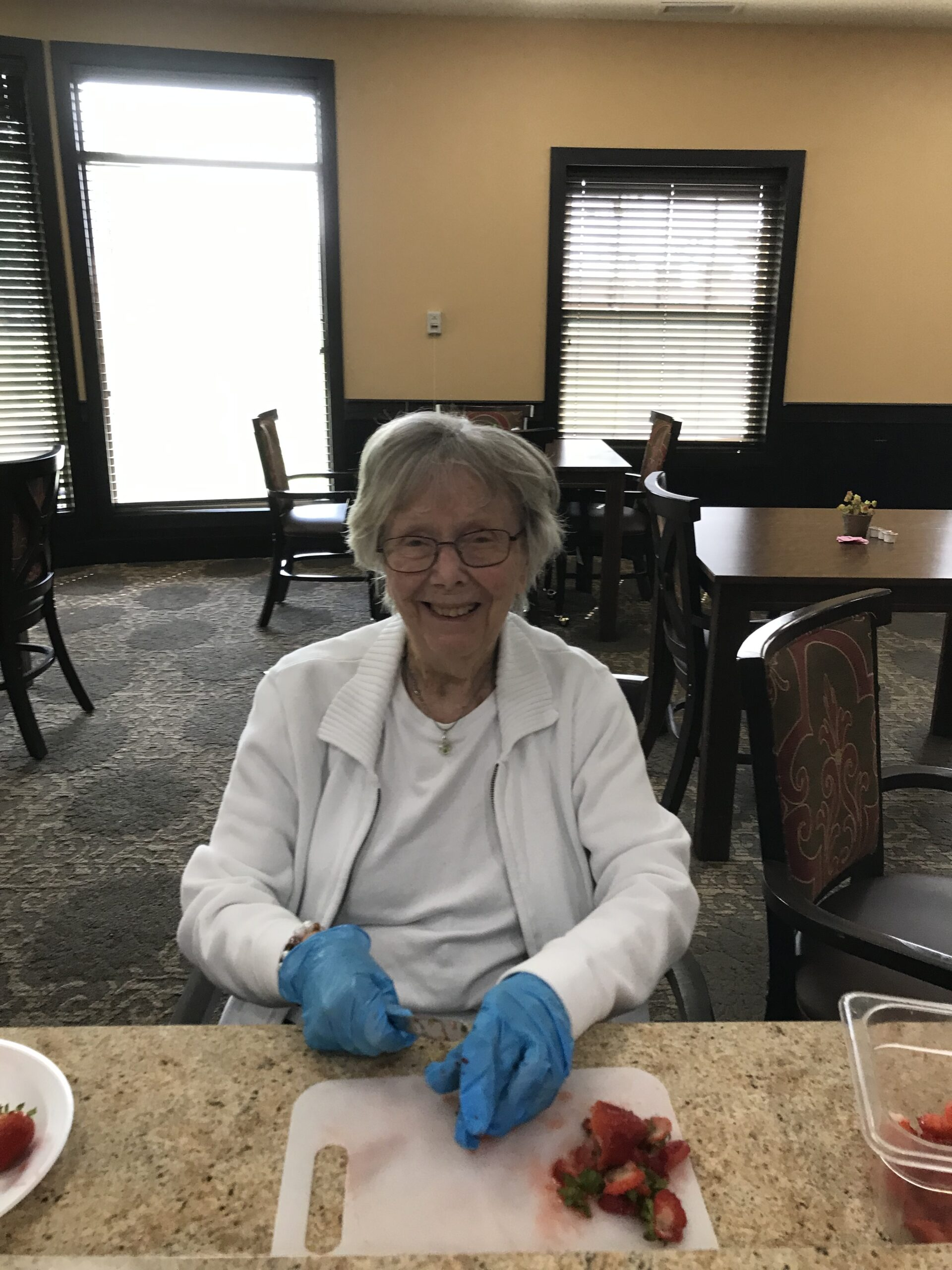 Norma helping cut up strawberries for ice cream sundaes