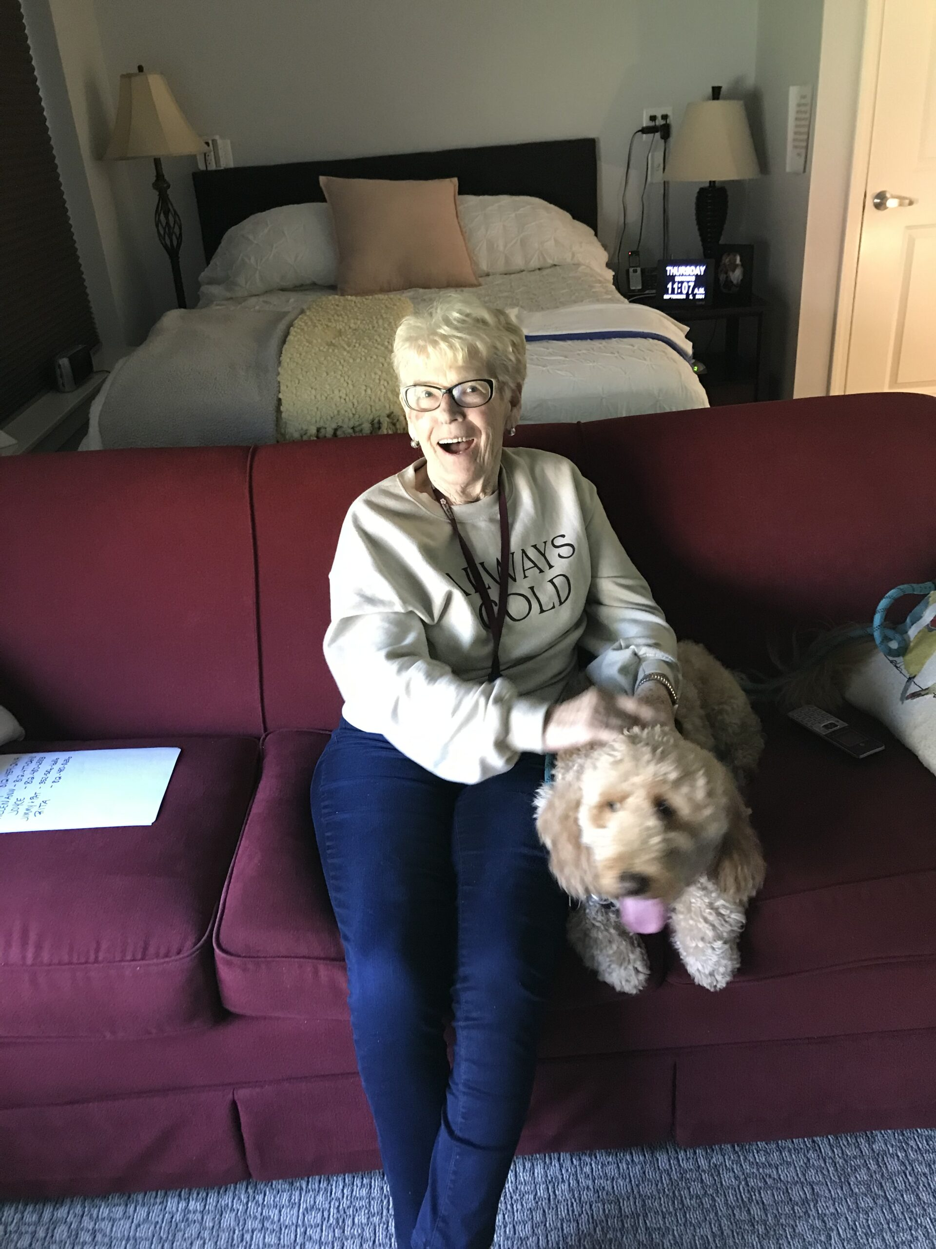Colleen visiting with Roscoe the Therapy Dog