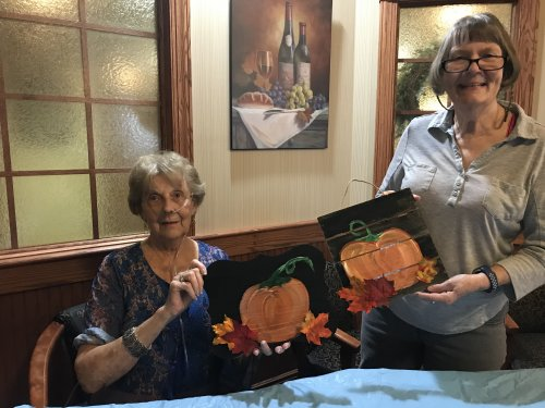 our fall pumpkin painting for our doors. Yes we are artist.