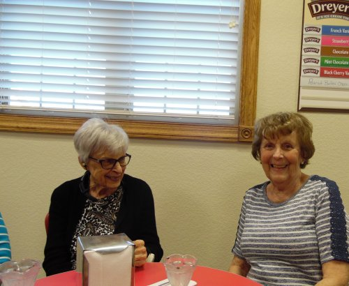 Peggy and Margaret found their smiles at the bottom of their ice cream cups.