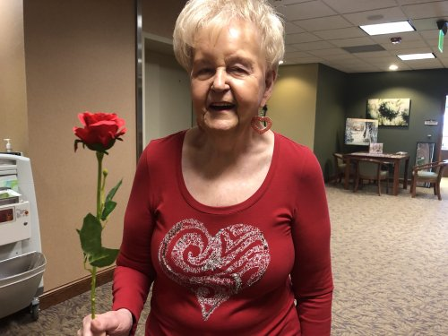 Joyce P. was dressed for the occasion today and was so happy about her rose!