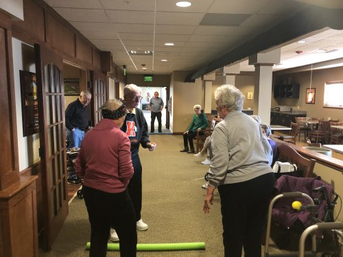 A super fun game of bocce ball in the hall way!