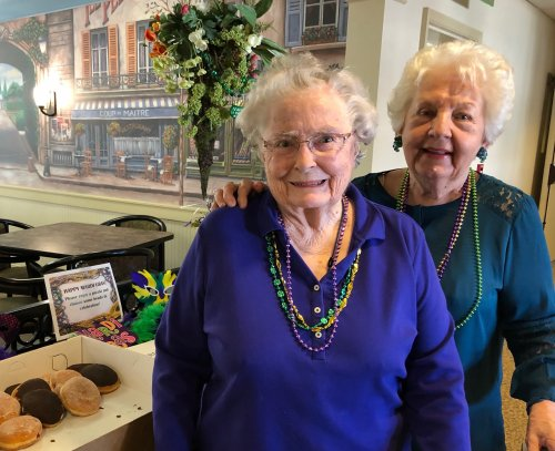 Mary Lou & Jean have gotten their beautiful beads and are picking out a yummy paczki.