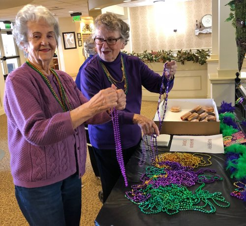 Jean & Marie are having fun choosing which Mardi Gras beads to wear.