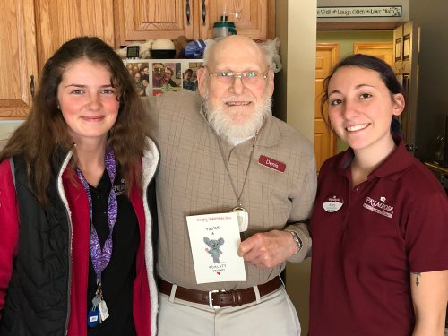 Housekeepers Mary and Karly made valentines for every resident! Denis shows his off.