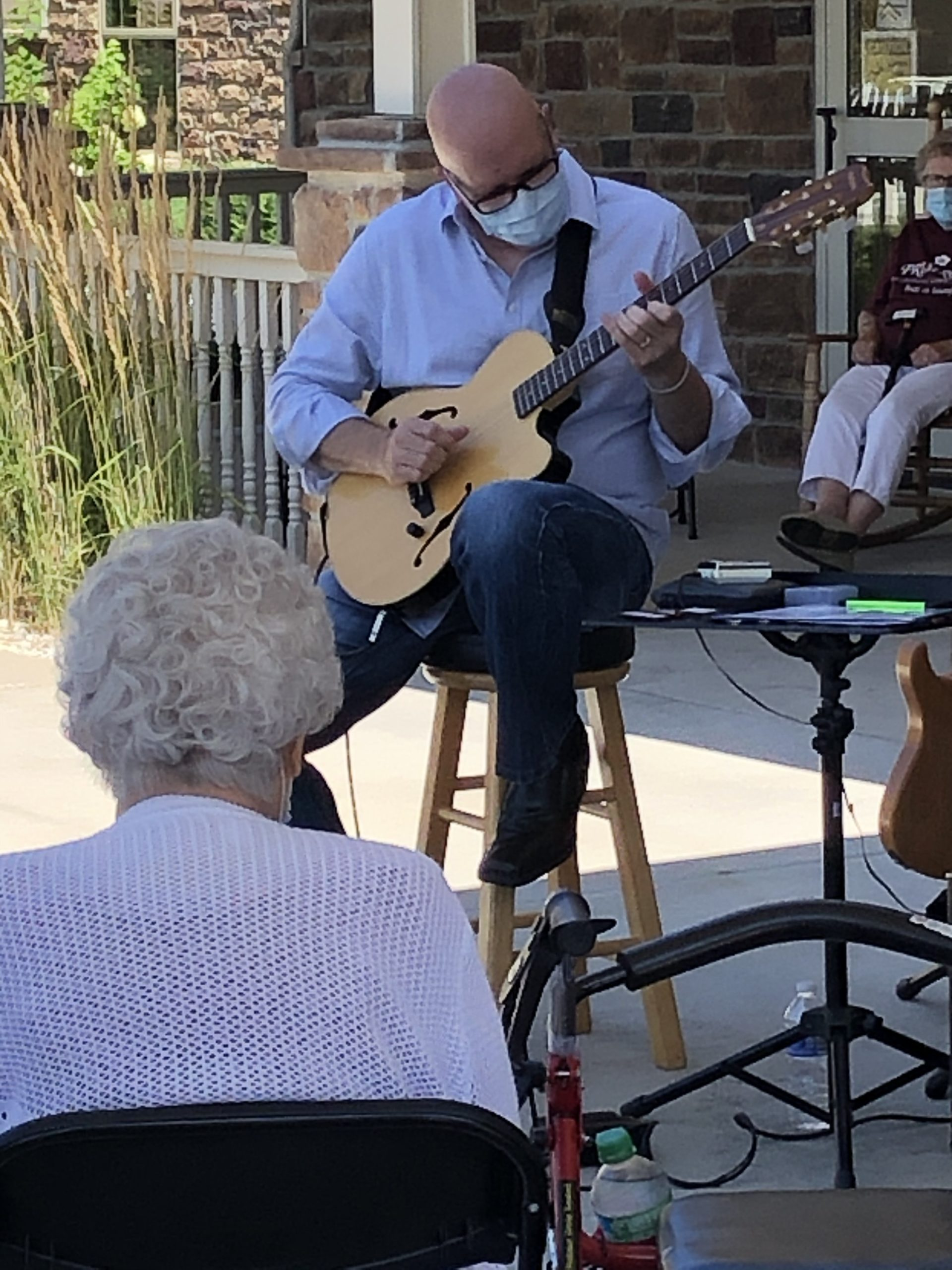 Mike DeRose playing guitar for our residents